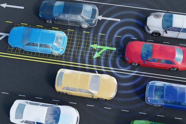 Image of vehicles on a motorway going both directions with an autonomous self-driving car analysing traffic situation on the road with sensors and artificial intelligence.